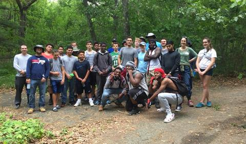 Medford High's football team posing for a group shot at the 90mm site (a meadow landscape)