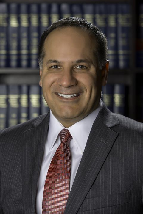 Partner Kenneth P. Hazouri