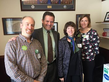 Ellen Curren posing with State Representative Michael Day and other constituents