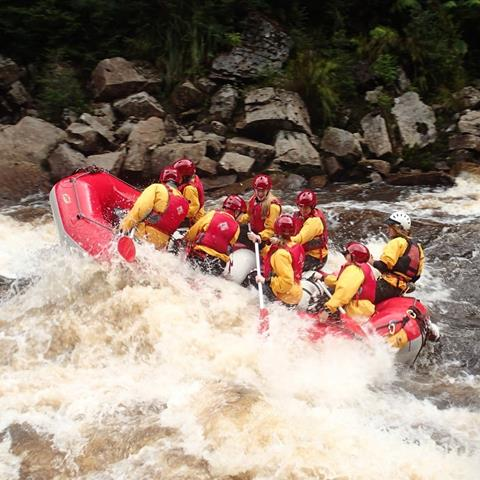 Get your adrenaline pumping with a white water adventure on the King River. Photo by King River Rafting.