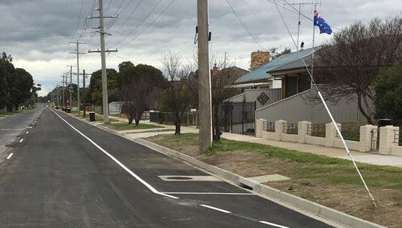 New pavement, kerbs and linemarking on Oak Street in Seymour with houses in the background