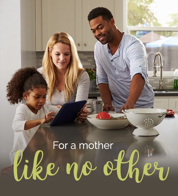 For a Mother like no other. Mixed family uses tablet computer in kitchen.