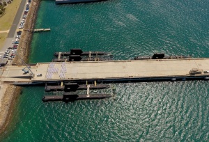 Five submarines alongside Diamantina Pier, Fleet Base West, HMAS Stirling. The Government will need to make a strategic decision on where the 12 future submarines should be based. Credit: Defence