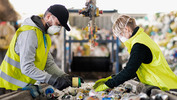 Two people sorting recycling