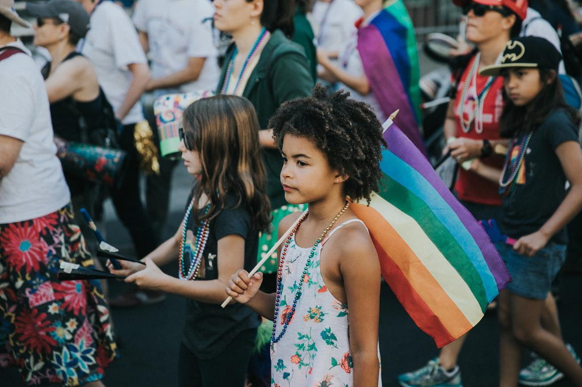 Girl with rainbow flag