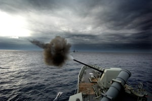 HMAS Warramunga fires her five-inch gun off the coast of NSW.