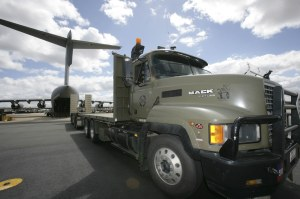 A Mack Fleetliner from Army's 26 Transport Section (26 TPT) prepares to be loaded aboard a RAAF C-17 Globemaster III heavy lift aircraft.