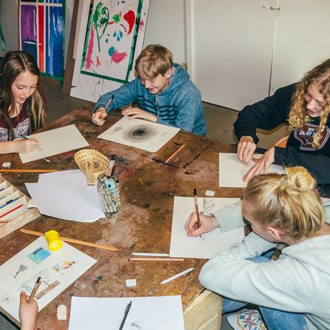 A group of teens participate in a Craft Night in Tofino