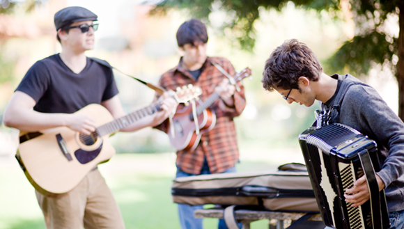Band playing music in park.