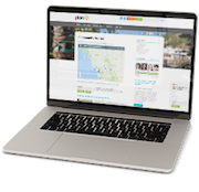 Laptop with the PlanH Community Stories page displayed.