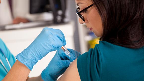 Women receives vaccination