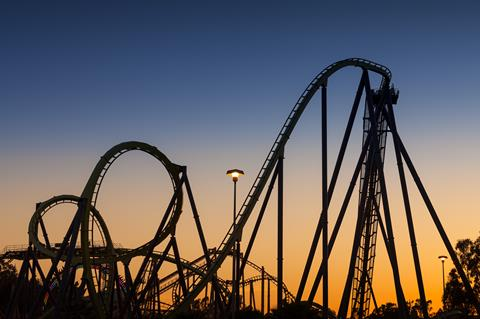 Rollercoaster with many ups and downs at sunset