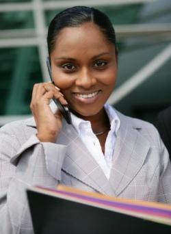 Business women talking on the phone with a folder in front of her.