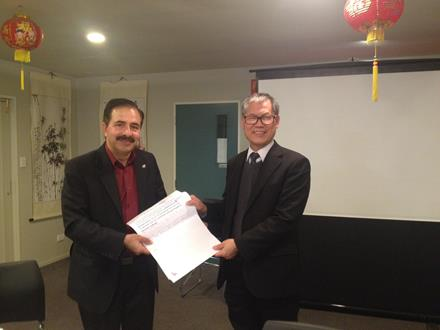 Surinder Tandon, President of the Christchurch Multicultural Council,  presents Counsellor Jimmy Chen, (Chairman of Christchurch City Council's Multicultural Working Party) with feedback on the draft Multicultural Strategy for Christchurch.