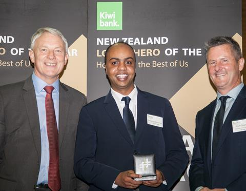 Mohamud (Centre) receiving his Local Hero Award from the CE of Kiwbank (right) and the Mayor for Auckland Phil Goff (left)