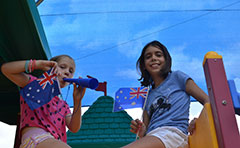 Girls waving flags
