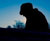Silhouette of older man outdoors