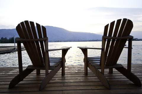 Chairs on a dock looking out at a lake