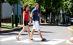 Couple walking across road