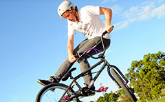 A photo of a youth doing a BMX trick on school holidays