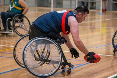 Man playing AFL Wheelchair