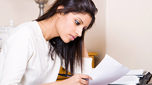 Young woman checking paper work