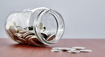 Jam jar spilling coins