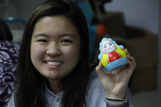 PA student holding her painted Tu'er Ye figurine