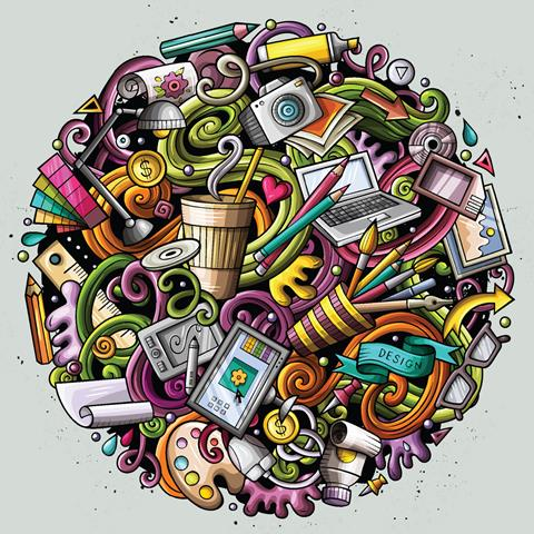 A circle made up of different items that reflect hobbies including a camera, a paintbrush, a laptop