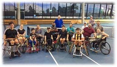 Group of people learning wheelchair tennis