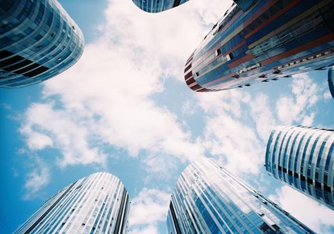 Looking up at a futuristic skyline