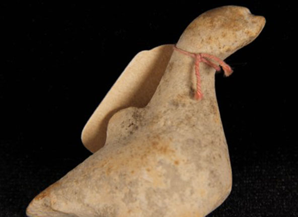Image of is a small terracotta bird
