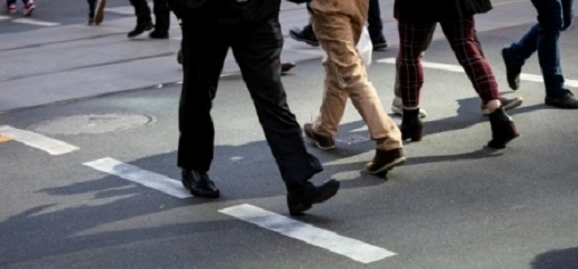 Pedestrians at busy intersection