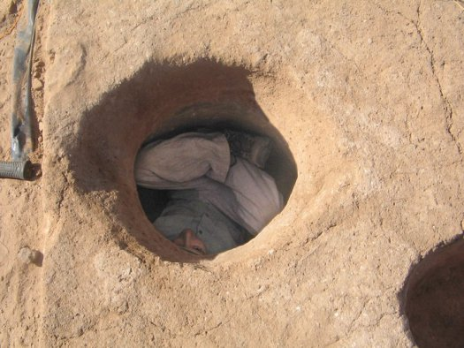 Inventory Specialist, John Bergman-McCool in a bell pit during an excavation in Arizona.