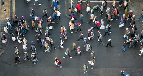 An aerial view of pedestrians crossing a road