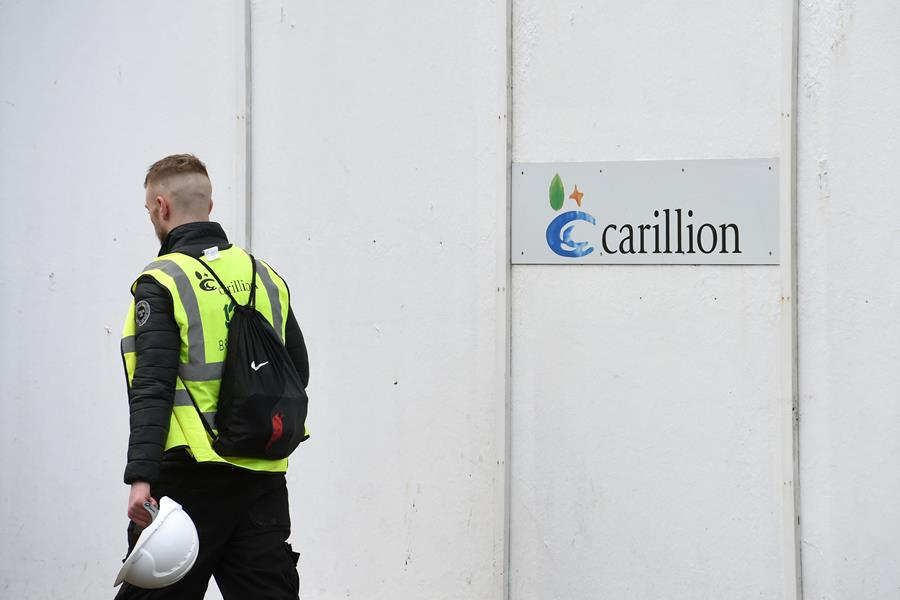 Keep going to work, Britain's May tells public service employees at Carillion
