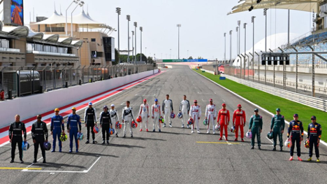Formula One racers standing on track
