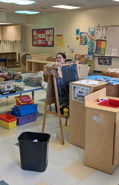 Whitter Kids staff member getting the space ready