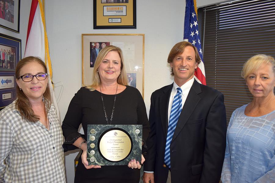 Clerk & Comptroller, Palm Beach County's Finance team holding GFOA's Distinguished Budget Presentation Award
