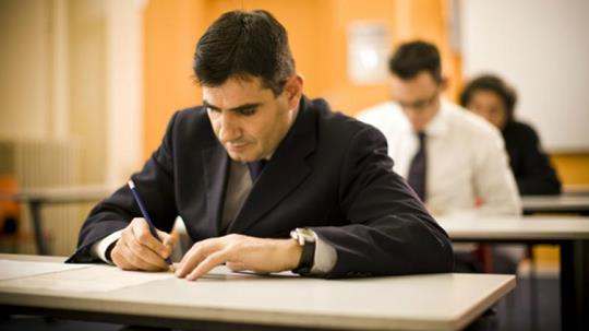 A man in suite taking a test