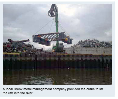 A local Bronx metal management company provided the crane to lift the raft into the river.