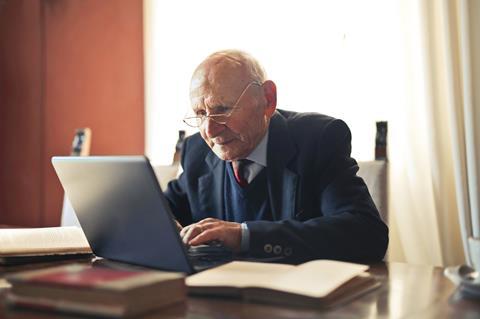 Older man learning on laptop