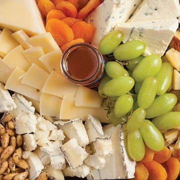 Artisan cheeses and grapes