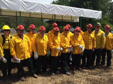Members of SERPPAS attend a prescribed burn.
