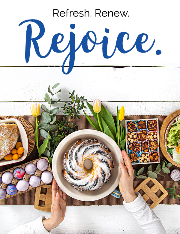 Refresh. Renew. Rejoice. Overhead shot of a bunt cake, eggs, baked goods and spring flowers.