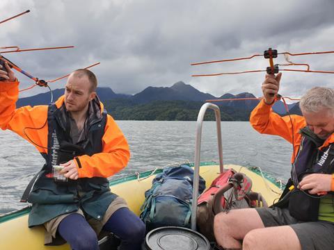 Remotely monitoring the kākāpō from boat.  Photo by B. Jeynes