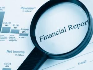 Magnifying glass over the words ' Financial report'