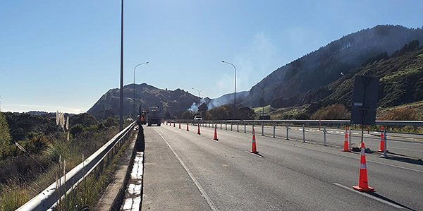 View of motorway with a truck in the distance installing street lights.